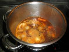 Add all other ingredients except milk and essence, simmer until vegetables are tender